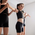 group-of-fit-happy-children-exercising-dancing-and-HR36N97-scaled.jpg